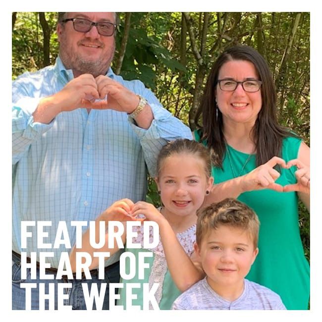 Woman and family make hearts with their hands